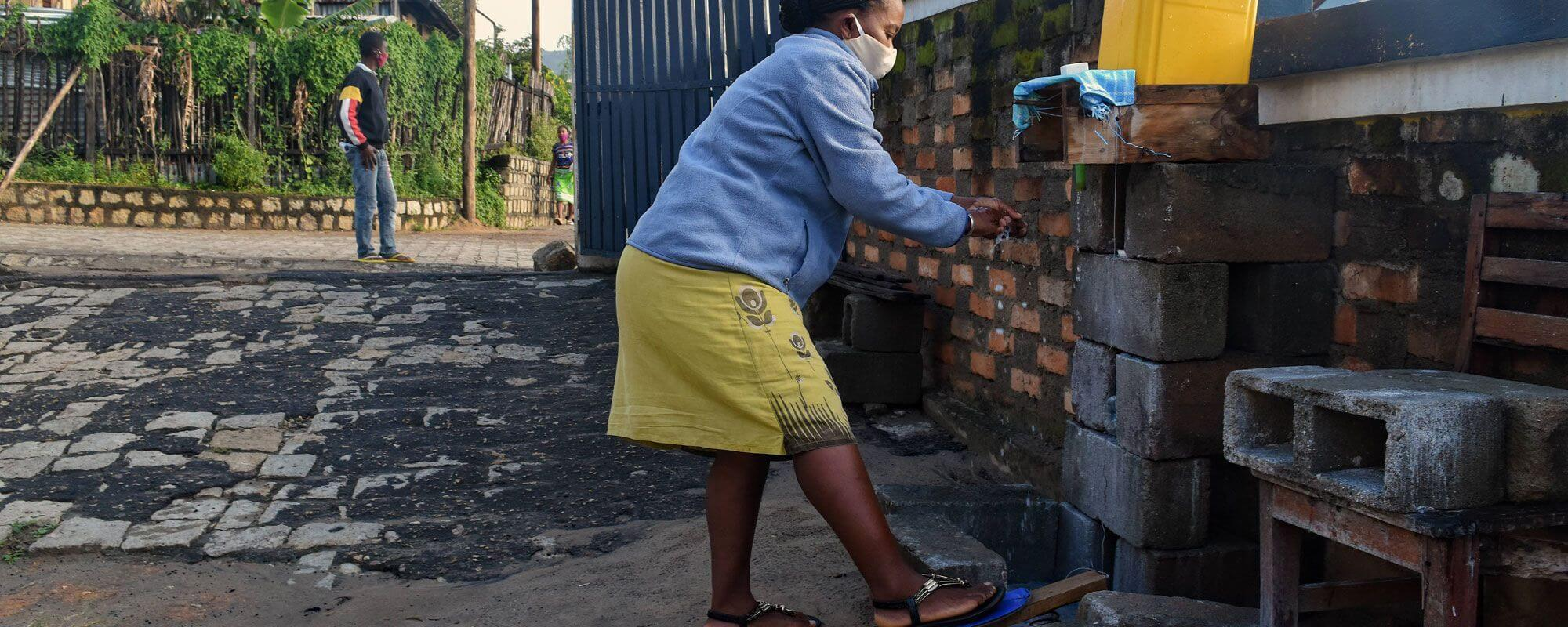Using the contactless handwashing station at the entrance to the SEED Madagascar office in Taolagnaro