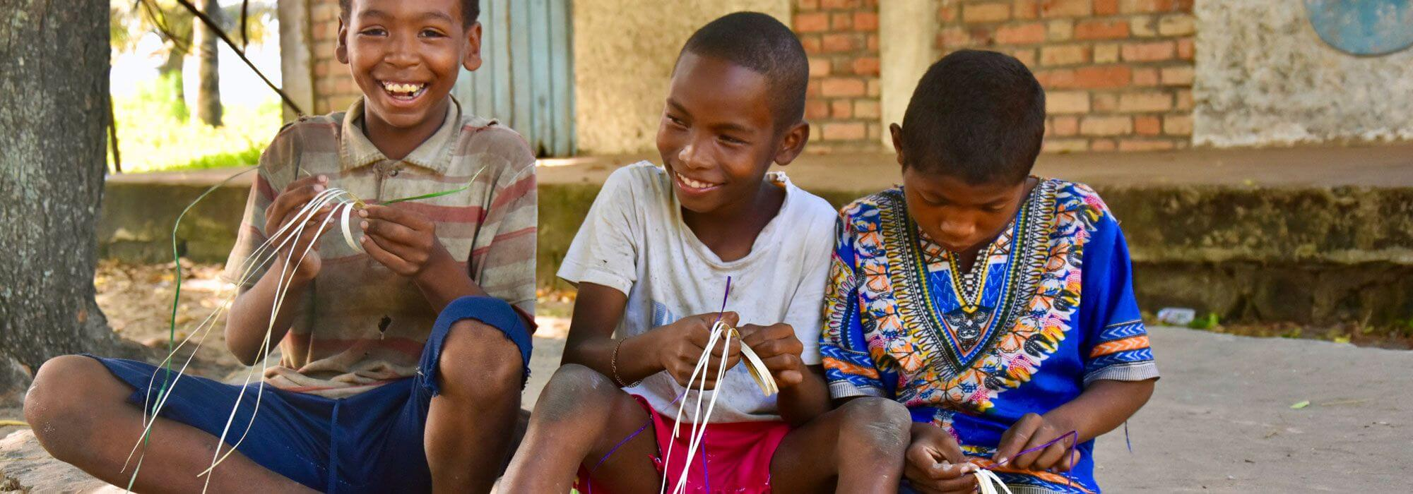 mahampy-children-weaving-bracelets-sainte-luce-outreach-youth.jpg