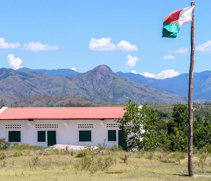Completed school building with Malagasy flag