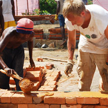 Tafa and a Pioneer bricklaying for a school