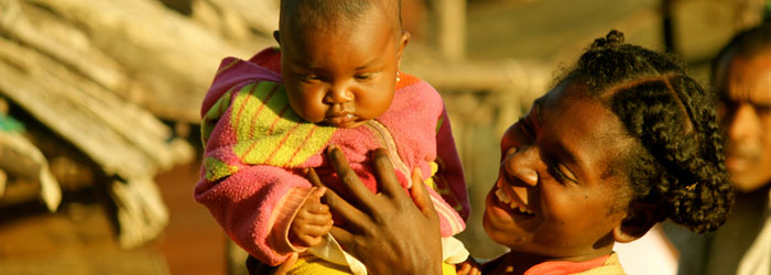 A malagasy mother holds up her child