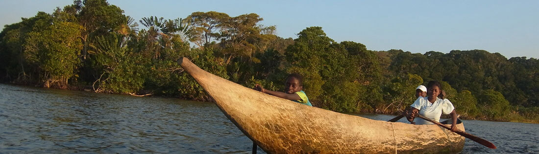 A pirogue (traditional wooden canoe) on a river