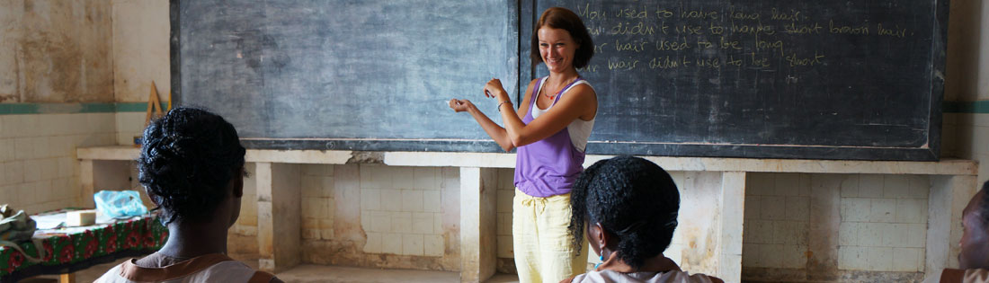A volunteer teaches an English class
