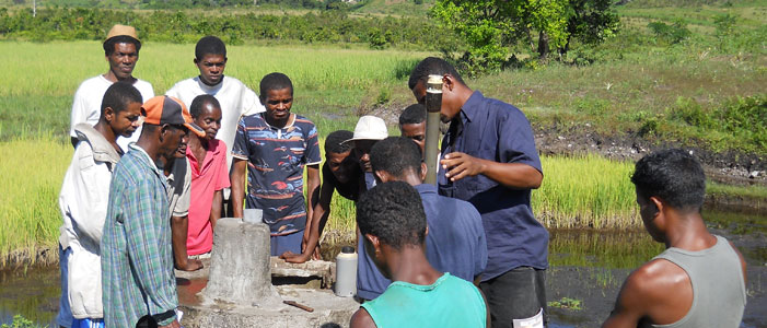An Azafady staff member shows local people how to repair a well